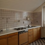 Kitchen with small black and white tiles